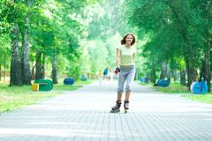 Roller skating sporty girl in park rollerblading Royalty Free Stock Photography