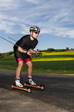 Roller skiing Stock Images