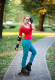 Roller sporty girl in park, woman outdoor fitness Royalty Free Stock Photo