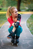 Roller sporty girl in park, woman outdoor fitness Stock Image