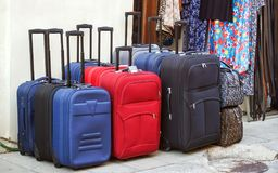 Roller Suitcases. Several roller suitcases exhibited on the street for sale Royalty Free Stock Photography