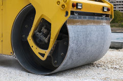 Roller tamping gravel Royalty Free Stock Photo