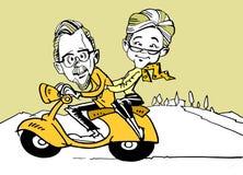 Roller und ältere Paare Stockfotos
