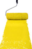 Roller With Yellow Paint Stock Images