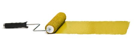 Roller with Yellow paint. Over white background - Stitched from three images stock images