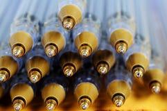 Rollerball pen tips. Gold coloured rollerball pen tips neatly stacked Stock Photos