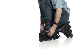 Rollerblade adjustment Royalty Free Stock Photography