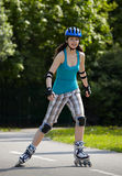 Rollerblade girl I. Young girl is rollerblading in the park Royalty Free Stock Images