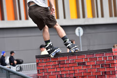 Rollerblade jump trick at a city background. Royalty Free Stock Image