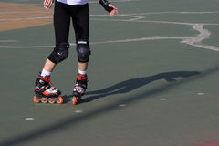 Rollerblade skater practicing tight slalom. A rollerblade skater practicing tight slalom Royalty Free Stock Images