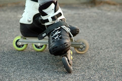 Rollerblade skates. Shoes with rollerblade skates royalty free stock images