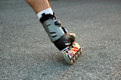 Rollerblade skating. Male foot,rollerbalde skaing royalty free stock photography