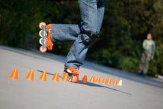 Rollerblader che fa i trucchi Fotografia Stock