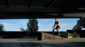 Rollerblader doing trick, slow motion. stock video footage