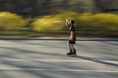 Rollerblader taking a drink royalty free stock image