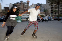 Rollerbladers, Beirut. Two rollerbladers holding hands, Beirut Royalty Free Stock Image