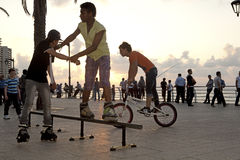 Rollerbladers performing tricks, Beirut. City seafront Royalty Free Stock Photos
