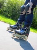 Rollerblades. Young woman rollerblading (inline skates royalty free stock photo