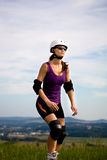 On rollerblades in the country Royalty Free Stock Photos