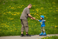 Rollerblades / inline skates teaching time Royalty Free Stock Images