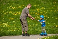 Rollerblades / inline skates teaching time Stock Photo