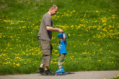 Rollerblades / inline skates teaching time Royalty Free Stock Photography