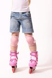 Rollerblades on the roller skater legs Royalty Free Stock Images