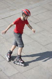 Rollerblading. Boy skating on the rollerblades Stock Photos