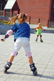 Rollerblading children. Stock Image