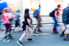 Rollerblading people on a city street Stock Image