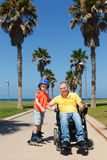 We rollerblading with son Stock Image
