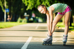 Rollerblading woman. Young attractive female fitness model is ha Stock Image