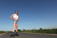 Rollerblading woman Royalty Free Stock Photo