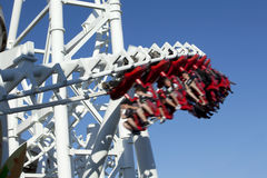 Rollercoaster. Hanging rollercoaster car speeding along a twisted track. .Taken in Wildwood New Jeresy Stock Photos