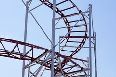 Rollercoaster against blue sky in the evening Stock Photos