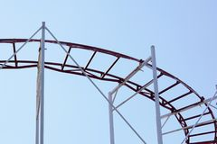 Rollercoaster against blue sky in the evening Stock Images