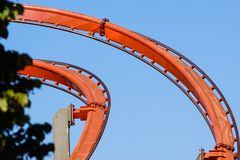 Rollercoaster against blue sky in the evening stock photo