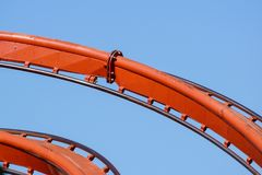 Rollercoaster against blue sky in the evening stock image