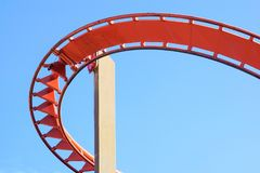 Rollercoaster against blue sky in the evening royalty free stock photos