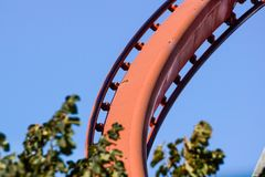 Rollercoaster against blue sky in the evening stock photography