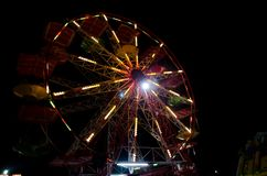Rollercoaster at amusement park. Wheel, roller coaster at amusement park by night close up Royalty Free Stock Photography