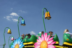 Rollercoaster for childrens in an amusement park. Against blue sky stock images
