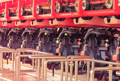 Rollercoaster with empty seat parking inside the station in the amusement park. Roller coaster with empty seat parking inside the station in the amusement park Royalty Free Stock Image