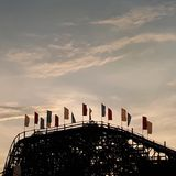 Rollercoaster flags at sunset Royalty Free Stock Photography