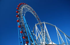 Rollercoaster amusement park against a blue sky Stock Photography