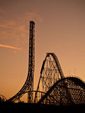 Rollercoaster heaven magic mountain. Lots of rollercoaster shot against orange sky during sunset. six flags magic mountain amusement park Royalty Free Stock Photography