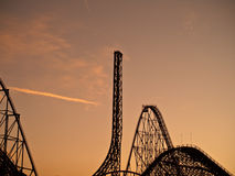Rollercoaster heaven magic mountain. Lots of rollercoaster shot against orange sky during sunset. six flags magic mountain amusement park Royalty Free Stock Photos