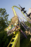 Rollercoaster ride. With the cart at the bottom of a drop. The cart is so motion blurred that you cannot identify who is riding stock photos