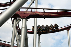 Rollercoaster. A screaming roller coaster speeds by Stock Images