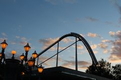 Rollercoaster Silhouette in the blue sky at dawn royalty free stock photography